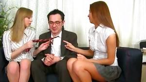 Threesome where both young harlots are pleasuring a massive lollipop