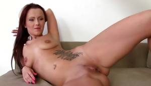 Red haired furious babe is lapping up a whip