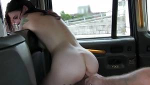 Aroused couple has the act of love in the taxi