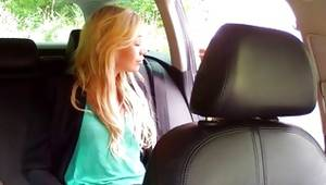 Racy sluttish whore posing in car looks hot